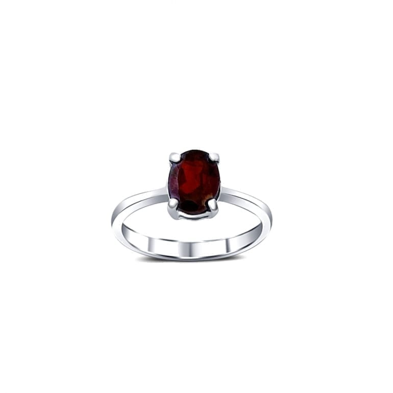A sterling silver ring with one central medium size garnet stone