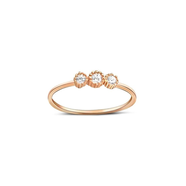 narrow rose gold ring with three cubic zirconia stones