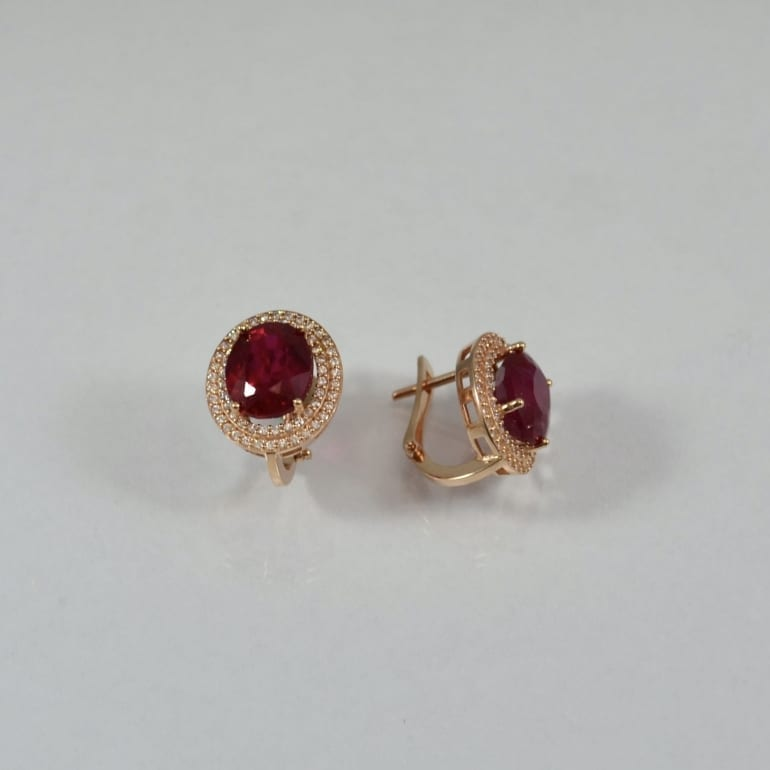 Rose gold earrings with oval ruby and cubic zirconia