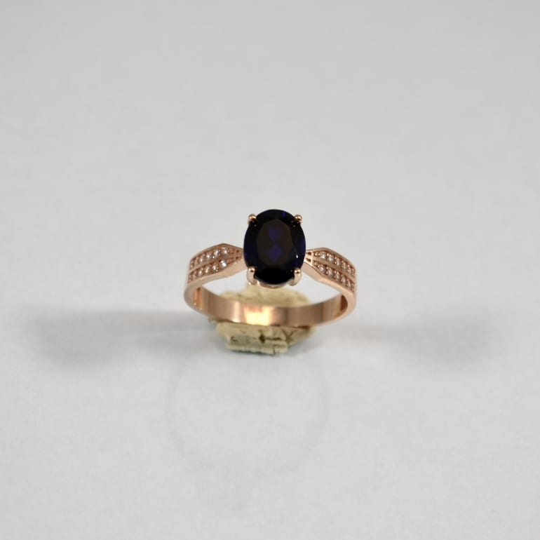Rose-gold-ring-with-sapphire-and-cubic-zirconia