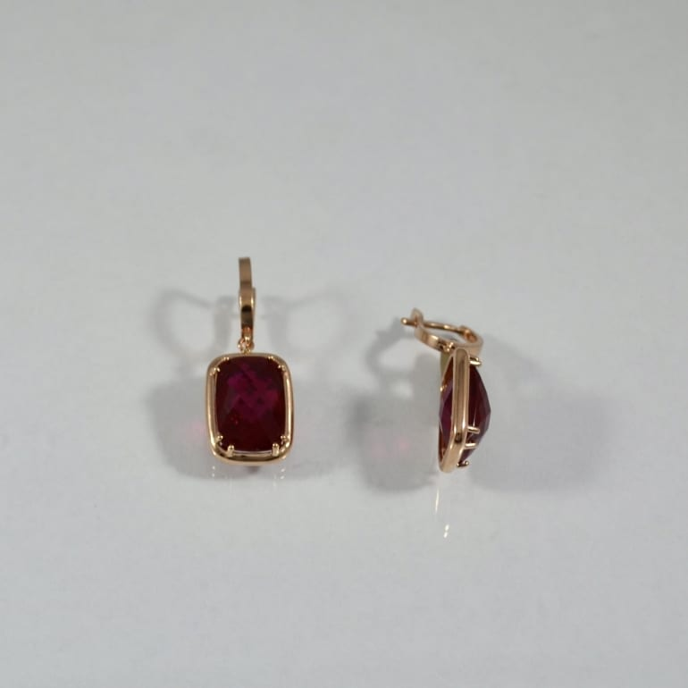 Rose gold earrings with large ruby