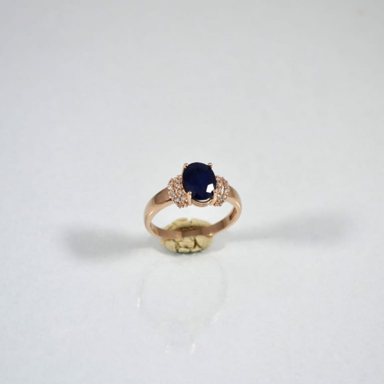Rose gold ring with sapphire and cubic zirconia
