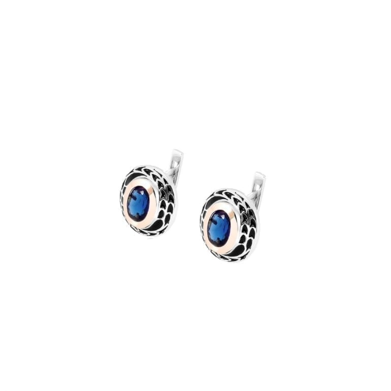 Sterling silver earrings with gold plates and blue cubic zirconia