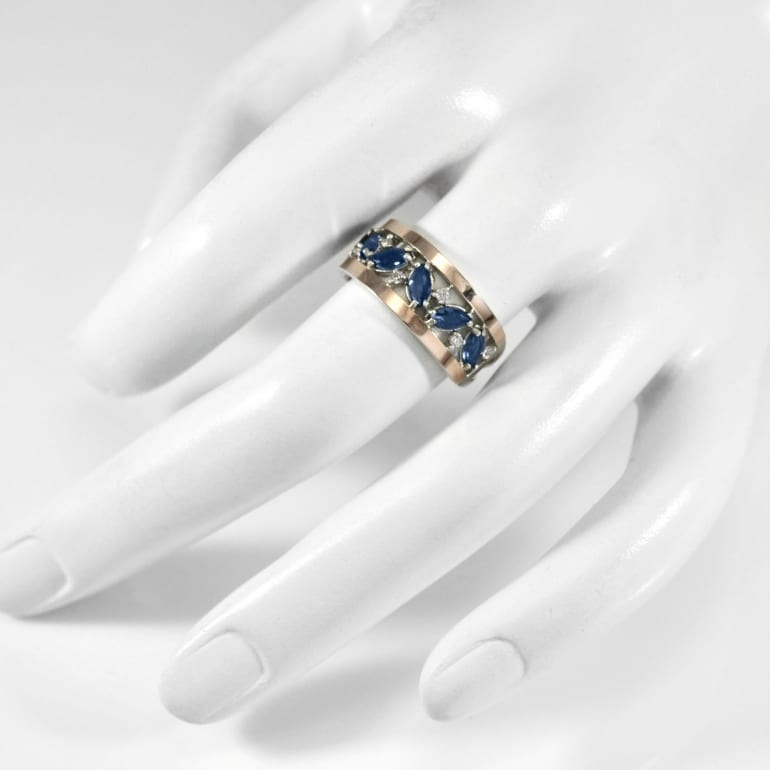 Sterling silver ring with gold plates and blue zirconia