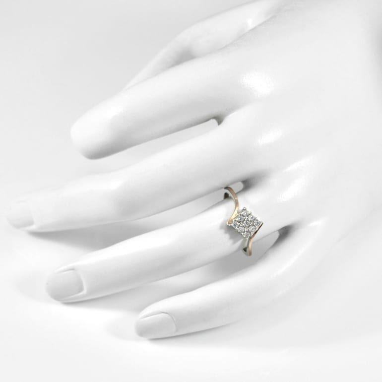 Sterling silver ring with gold plates and white cubic zirconia
