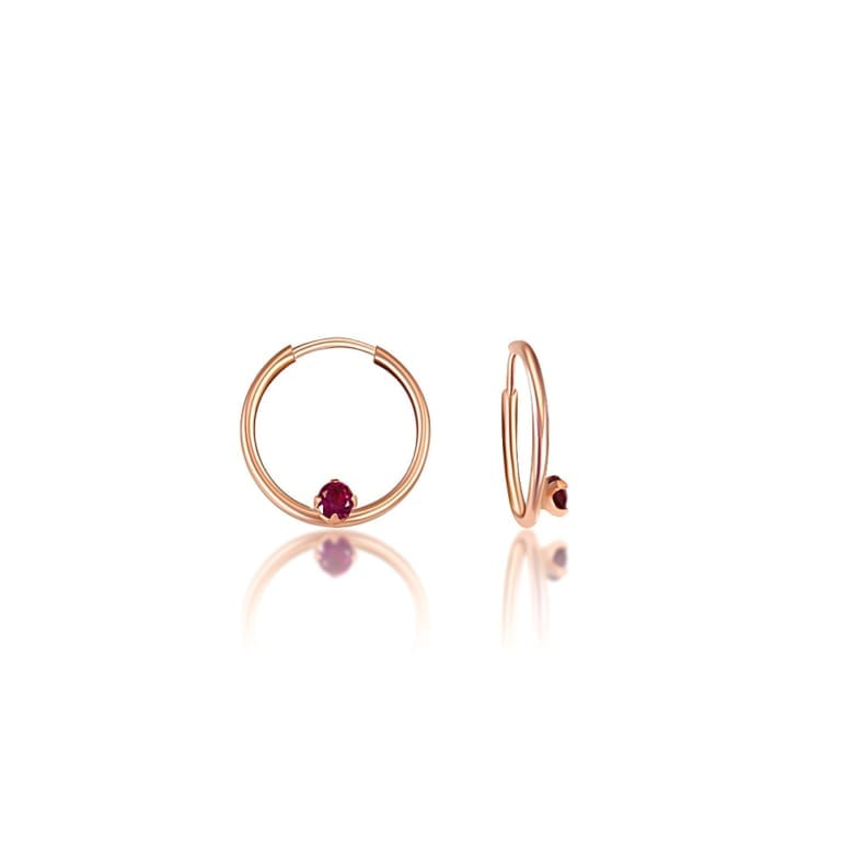 rose gold hoops with purple cubic zirconia
