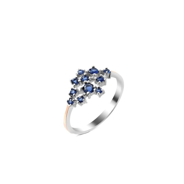 sterling silver ring with gold plates and blue cubic zirconia